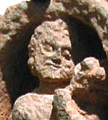 Detail of the face of a Kushan devotee
