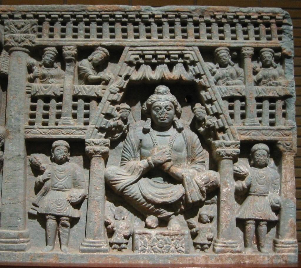Maitreya, with Kushan devotees, left and right, 2nd century Gandhara