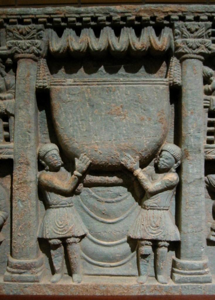 Kushans worshipping the Buddha's bowl. 2nd century Gandhara